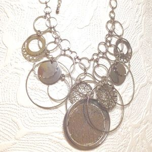 Jewelry - Mult-Ring Dangle Necklace.Bright Shiny Silver Tone